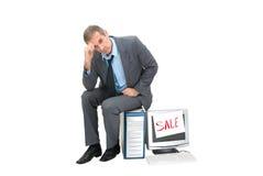Needy. The needy businessman sells office technics Royalty Free Stock Image