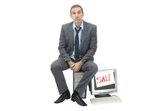 Needy. The needy businessman sells office technics Royalty Free Stock Photos