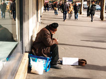 Senior age 84 Begging. Printemps Haussmann Paris Royalty Free Stock Images