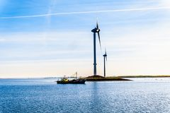 Fishing Boat and Wind Turbines at the Oosterschelde inlet at the Neeltje Jans island in Zeeland Province in the Netherlands. Neeltje Jans, Zeeland/the stock photos