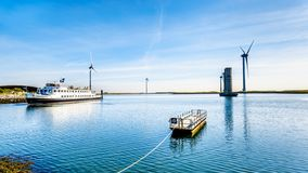 Tourist Boat at the Delta Works Storm Surge Barrier at the Oosterschelde departing from Neeltje Jans island royalty free stock photos