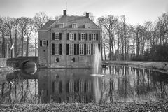 Neerijnen Castle with a fountain in the moat Royalty Free Stock Images