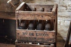 NEERIJSE, BELGIUM - SEPTEMBER 05, 2014: Wooden box with old vintage beer bottles in the brewery De Kroon in Neerijse. royalty free stock images