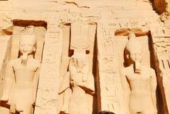 Nefertari and Ramses II. Nefertari flanked on both sides by Ramses II at Abu Simbel, Egypt Royalty Free Stock Photography