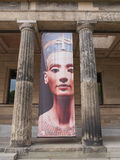 Nefertiti at Neues Museum Berlin. BERLIN, GERMANY - MAY 10, 2014: Banner with Egyptian queen and Sun Goddess Nefertiti in front of the Neues Museum which hosts Royalty Free Stock Photography
