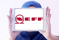 Neff company logo. Logo of Neff company on samsung tablet holded by arab muslim woman. Neff is a German manufacturer of high-end kitchen appliances headquartered Royalty Free Stock Photography