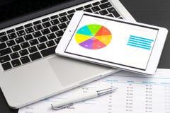 Negócio analítico com PC da tabuleta imagens de stock