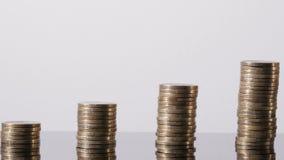 Negócio crescente Tendência de Positiv Pilha das moedas video estoque