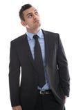 Negócio: homem novo no terno que pensa com mão no isolado do bolso Imagem de Stock Royalty Free