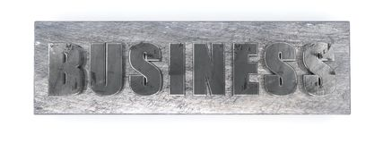 Negócio, letras do metal no branco Foto de Stock