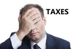 Negócio no esforço com impostos do título imagem de stock