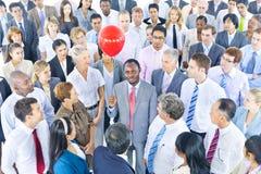 Negócio Person Standing Around o um vermelho guardando Fotografia de Stock Royalty Free