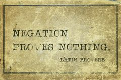 Negation LP. Negation proves nothing - ancient Latin proverb printed on grunge vintage cardboard Royalty Free Stock Image