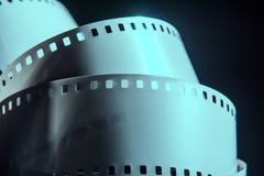 Negativ rulle av filmen på en mörk bakgrund arkivbild