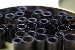 Negativas del archivo de la película en una poder redonda del metal Foto de archivo libre de regalías