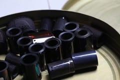 Negativas del archivo de la película en una poder redonda del metal Imagen de archivo libre de regalías