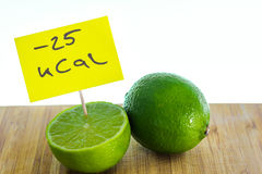 Negative-calories food, limes on a cutting board Stock Photography