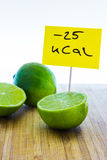 Negative-calories food, limes on a cutting board Royalty Free Stock Image