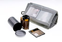 Negative and digital film. Storage canister and card wallet with card. Macro Stock Photos
