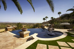Negative edge modern mansion outdoor swimming pool Royalty Free Stock Photo