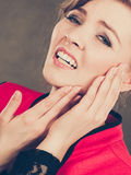 Negative emotion. Woman having tooth ache. Stress and pain. Face of young painful woman. Female feeling tooth pain ache. Girl touching her mouth teeth by hand royalty free stock photos