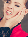 Negative emotion. Woman having tooth ache. Stress and pain. Face of young painful woman. Female feeling tooth pain ache. Girl touching her mouth teeth by hand stock image