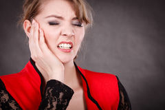 Negative emotion. Woman having tooth ache. Stress and pain. Face of young painful woman. Female feeling tooth pain ache. Girl touching her mouth teeth by hand royalty free stock image