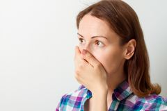 Young woman covered her mouth with her hand Royalty Free Stock Photo