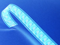 Negative film reel blue toned Stock Image
