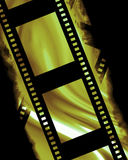 Negative film strip. Blank negative film strip on a dark background Royalty Free Stock Photography