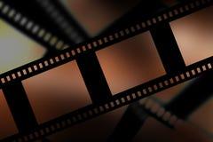 Negative film strip. On dark background Stock Photos