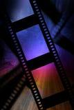 Negative film strip. With blue glow Stock Image