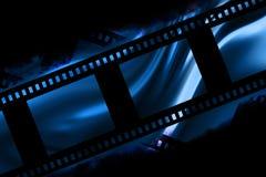 Negative film strip. Blank negative film strip on a dark background Stock Photos