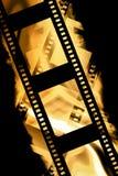 Negative film strip. Blank negative film strip on a yellow like background Royalty Free Stock Image
