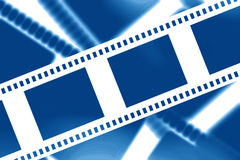 Negative film strip. On a blue background Royalty Free Stock Photography