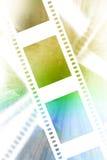 Negative film strip. On a soft pastel background Royalty Free Stock Photos