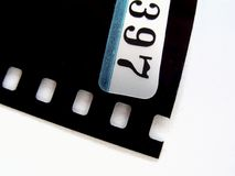 Negative film strip. Numbered negative film strip isolated on white background stock photography
