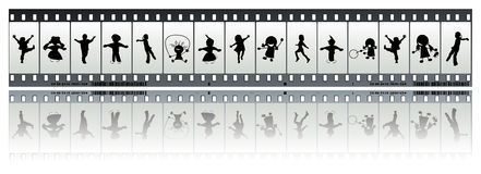 Negative film strip with children. 35 mm film with children silhouettes Royalty Free Stock Images
