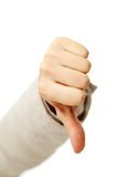 Negative gesture. Image of human hand showing thumb down in isolation Stock Photography