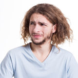 Negative human emotion, man expressing disgust. Negative human emotion. Man expressing disgust on face, grimacing on white studio background, cutout royalty free stock photography