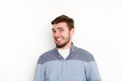 Negative human emotion, man expressing disgust. Man expressing disgust on face, grimacing on white studio background, cutout. Negative emotions stock image