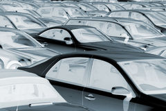 Negative image of parked cars. Blue toned, negative image of rows of parked cars Royalty Free Stock Photos