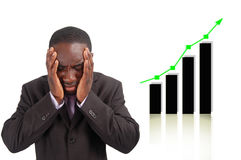 Negative Impact. This is an image of businessman frustrated by the rise in the graph which has affect his company sales. This can be used to represent themes stock photos
