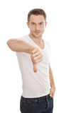 Negative man with thumbs down Stock Image