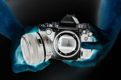 Negative photo of SLR camera in hands photographer closeup Royalty Free Stock Photos