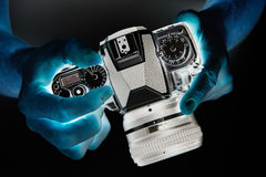 Negative photo of SLR camera in hands Stock Images