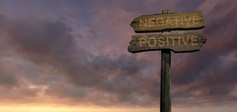 NEGATIVE - POSITIVE. Old wood direction sign Stock Image