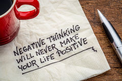 Negative thinking and posifitive life. Negative thinking will never make your life positive - inspirational handwriting on a napkin with a cup of coffee Royalty Free Stock Photos