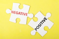 Negative versus positive. Concept on two pieces of jigsaw puzzles Royalty Free Stock Photos