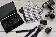 Negatives and photographic slides with analog photographic equipment and laptop